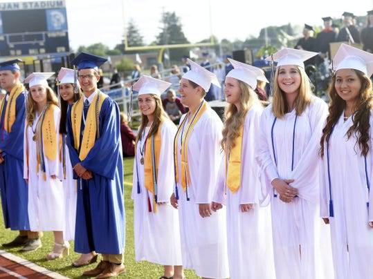 The Chambersburg Area Senior High School senior class officers watch the processional Friday during the CASD graduation at Trojan Stadium. See the photo gallery of the graduation at photos.publicopiniononline.com.