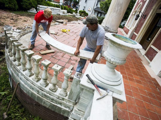 Bill Sterner gets help removing a marble railing June 9 from his son John Sterner, left, both with William Sterner Masonry. The work is part of a renovation project that began this month at Sheppard Mansion on Frederick Street in Hanover.