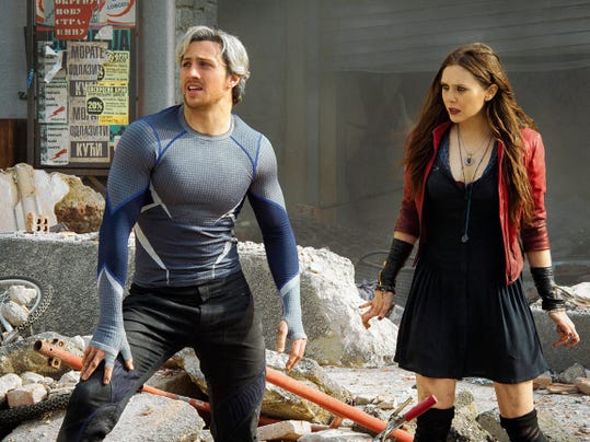 """Aaron Taylor-Johnson as Quicksilver/Pietro Maximoff and Elizabeth Olsen as Scarlet Witch/Wanda Maximoff, in a scene from the film, """"Avengers: Age of Ultron.""""  The Avengers get some new, hostile company in """"Age of Ultron"""" in a pair of mysterious and enhanced twins, played by Olsen and Taylor-Johnson, and a sinister robot with delusions of grandeur, played by James Spader. The movie opens in U.S. theaters Friday."""