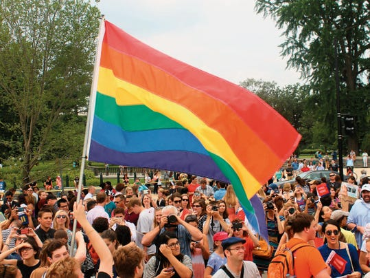 Crowds gather on Friday in front of the Supreme Court in Washington, D.C., following news that the highest court in the land had upheld same-sex couples' right to marry in all 50 states. Sky Klaus - Sun-News