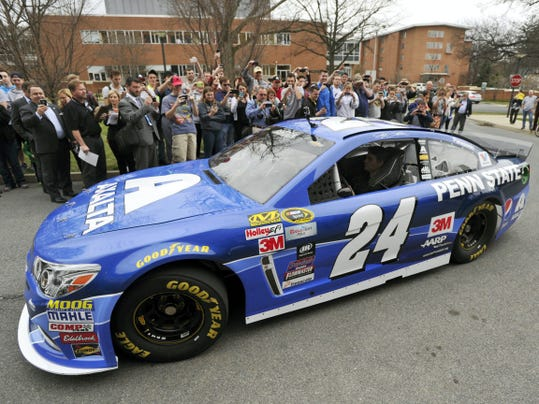 People take pictures on Tuesday of the street version of a blue and white Penn State race car that NASCAR driver Jeff Gordon will drive for a June race at Pennsylvania's Pocono Raceway. The event took place on the school's campus in State College, Pennsylvania.