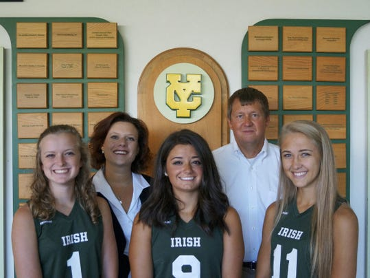 Pictured from left, in the front row, are York Catholic girls' lacrosse players Lindsey China, Maura Palandro and Lisa Casagrande. In the back, from left, are York Catholic principal Katie Seufert and York Catholic girls' lacrosse head coach Rob Linthicum. The players were named to the US Lacrosse 2015 Girls' High School All-Academic Team.