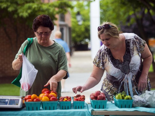 Shoppers such as Lee Nussbaum, left, search for produce during the Adams County Farm Fresh Market on July 8 in Gettysburg. The Adams County Farm Fresh market is held every Wednesday at the Gettysburg Heritage Center from 2 to 6 p.m. and every Friday and Saturday at the Outlet Shoppes in Gettysburg from 9:30 a.m. to 2 p.m.
