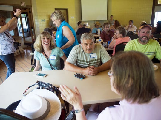 Pat Smith, of Shrewsbury, foreground, chats with Lisa and Brin Dempski, of Wilkes-Barre, at the eagle cam picnic at Codorus on Sunday.