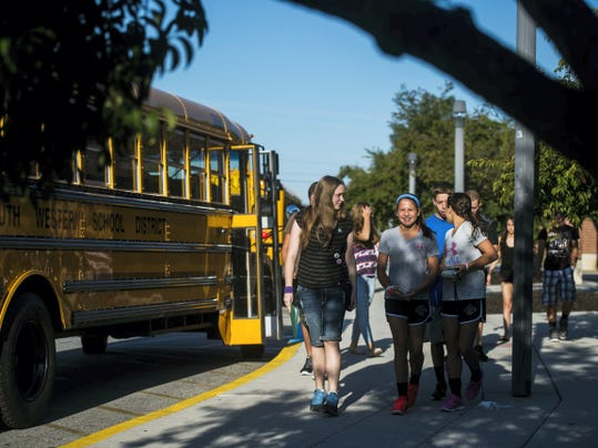 South Western High School ninth-grade students arrive Tuesday morning for the first day of school at South Western School District. Tuesday was the first day back to school for students in kindergarten through ninth grade.