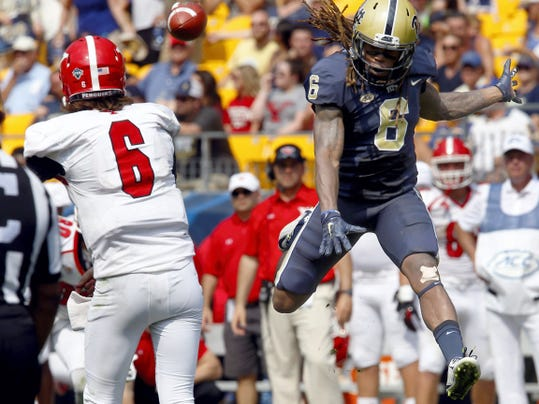 Pittsburgh defensive back Lafayette Pitts, right, leaps to put pressure on Youngstown State quarterback Hunter Wells as he gets a pass away during the third quarter of Saturday's game in Pittsburgh. Pittsburgh won, 45-37.