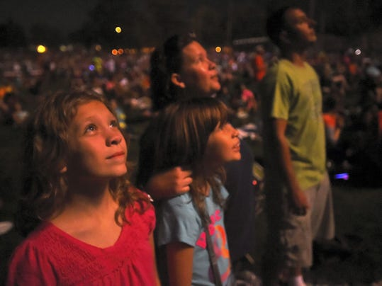 Carla Craig, 12, left, McKenna Craig, 9, their mom Kim Craig and friend Robert Washinko watch the fireworks at Chambersburg Memorial Park on Saturday. The annual fireworks, culminating the Day in the Park event were postponed from July 4 because of rainy weather.