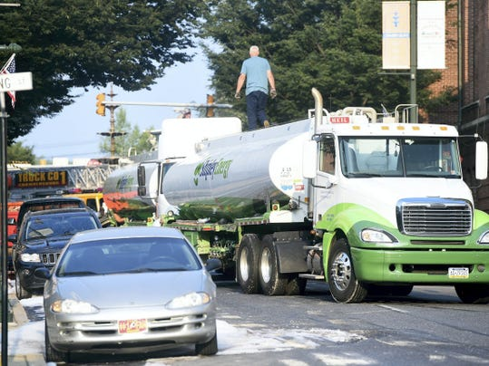 A second Shipley Energy truck is brought in to drain the first truck of its remaining fuel on Tuesday, July 28, after a fuel truck struck a dumpster in downtown Chambersburg.