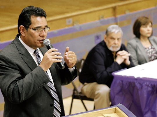 MARK LAMBIE—EL PASO TIMES EPISD school board district 2 candidate Al Velarde fields the first round of questions as his opponents Luis de la Cruz and Mayela Sanchez Serrano await their turns.