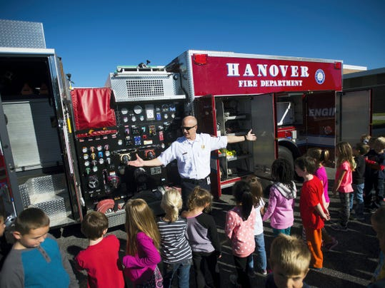 Capt. Geoff Miller with Penn Township Fire Department explains to students equipment on board Hanover Fire Department's engine truck Tuesday at Park Hills Elementary School as part of Fire Prevention Week. Firefighters are traveling to Hanover-area preschools, day cares and elementary schools this week to teach students about fire prevention and safety.