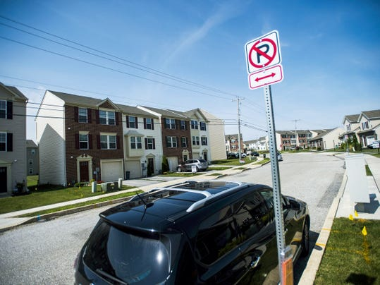 No parking signs are visible along Blossom Drive in the Cherry Tree development in Hanover on Aug. 6.