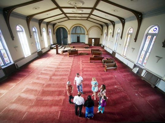 People gathered in the former sanctuary of Zion Lutheran Church in 2014 as they discussed possible uses for the building. The effort continues to find a use.