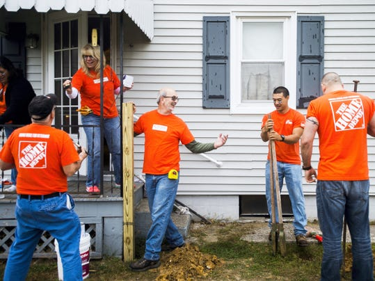 "Home Depot associates work at the home of Lawrence ""Gump"" Bolin on Tuesday in McSherrystown."