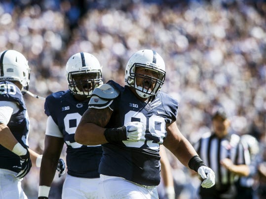 Penn State's Austin Johnson (99) celebrates after making a tackle during Saturday's game against Indiana at Beaver Stadium.