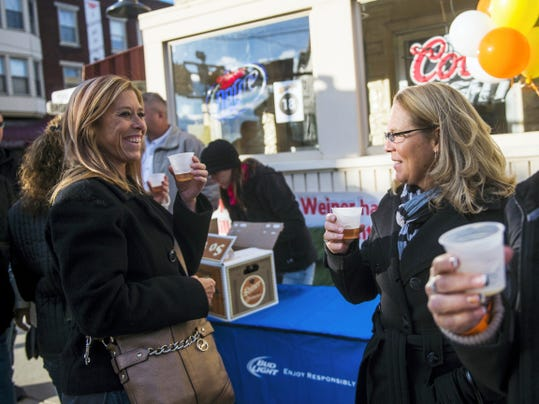 Deb Dubs, left, and Stacie Staub, right, both from Hanover, enjoy samplings of Shiner Oktoberfest beer Saturday during Main Street Hanover's Oktoberfest event.