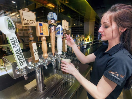 Jessica Flynn pours a Center Square pale ale at the The Altland House in Abbottstown Wednesday January 21, 2015. the taps also feature other local brews, Crystal Ball from West York and American Blond from Hanover.  Paul Kuehnel - Daily Record/Sunday News