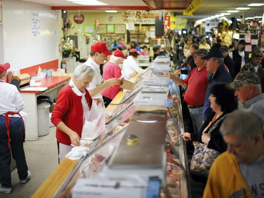 Richard M. Heagy Meats from East Petersburg rolls through orders during the early morning rush on Good Friday at the Green Dragon.  Patrick Blain — For the Lebanon Daily News
