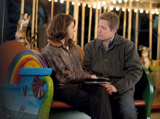 "Hugh Grant portrays a screenwriter experiencing career crisis when he accepts a teaching position. Marisa Tomei is one of his students, a mother returning to college in ""The Rewrite."""