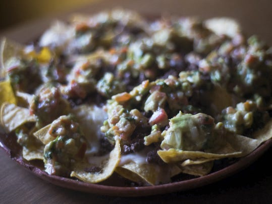 El Rancho's Nachos Supreme includes cheese, guacamole, beans and steak as well as three variations of salsa,