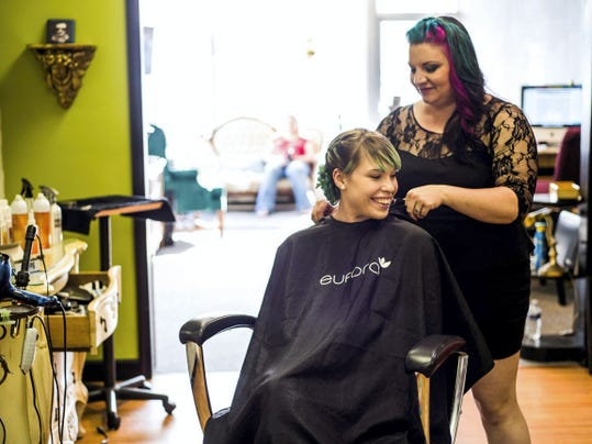 Jennifer Snyder of Rock Paper Scissors Salon in Hanover takes the cape off of Macy Keefer after finishing an updo a few months after the salon opened in 2014.