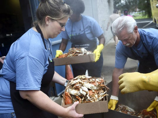 Servers grab crabs at the 19th annual Crabfeast in 2014 at the AMVETS pavilion in Chambersburg.