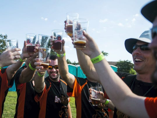 Members of the Brew Crew, a beer drinking club from York, make a toast Saturday during the second annual Gettysburg Brew Fest at Lutheran Theological Seminary in Gettysburg.
