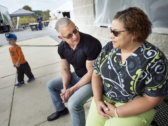 "Robert Irvine, celebrity chef, left, talks with Alysha Bauer, of Red Lion, who stopped by during a ""Restaurant: Impossible"" makeover at Cape Horn Family Restaurant in York Township Wednesday. Adam Loss, 3, of Red Lion, showed up wearing his hard hat."