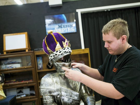 Tyler Mudgett, of Littlestown, adjusts a tin knight in armor at his store booth at the Markets at Hanover on Broadway on Oct. 22 in Hanover. Mudgett, who's in the spectrum for Autism, gets support and help from Focus Foundation, which has their fundraising booth next door, in running his store that specializes in medieval swords and items, a hobby Mudgett says he's always enjoyed. Mudgett is also a client with Focus Foundation and gets to keep his profits from his store.