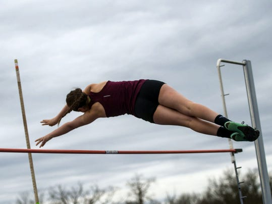 Gettysburg junior Kimberly Grasmick clears the bar during the pole vault event Tuesday at Gettysburg High School. Grasmick placed third as Grace Tyson won by clearing 9 feet, 3 inches.
