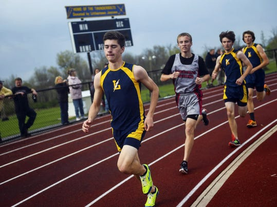 Littlestown's Michael Bittinger races during the Thunderbolts' dual meet with Bermudian Springs Thursday at Littlestown High School. Littlestown's boys' track and field team clinched the YAIAA Division III title with a 101-49 victory against Bermudian Springs.