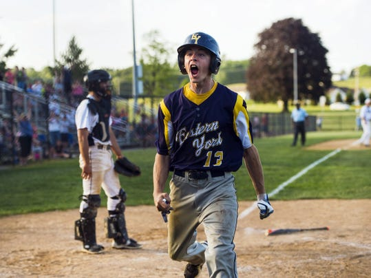 Eastern York's Robert Hedrick reacts after scoring the tying run against West York in the top of the seventh inning during the YAIAA championship Tuesday.