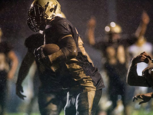 Delone's Zach Hart carries the ball for a touchdown in the fourth quarter of Friday's game against Littlestown.