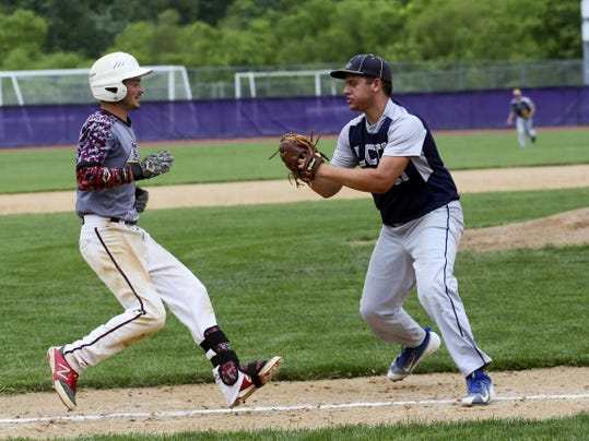Southern Fulton's Tristan Douglas, left, is about to be tagged out by pitcher Kyle Ebersole of Lancaster County Christian on his way to first base during a PIAA Class A semifinal game Monday. The game was suspended with LCC leading 3-0 in the fourth inning.