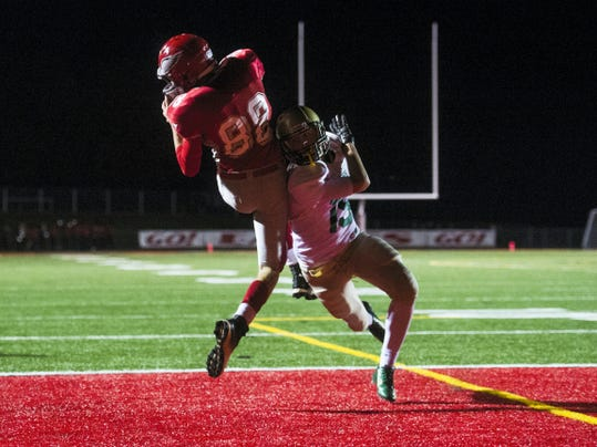 York Catholic's Joe Bauhof falls as Bermudian Springs' Quinton Nace catches the game-winning touchdown on Friday at Bermudian Springs High School. Nace scored in the final seconds on a pass from quarterback Tristan Hoke, as Bermudian Springs won 20-17.
