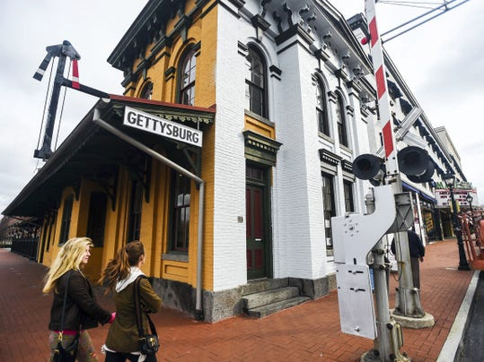 The Historic Gettysburg Train Station is getting a new coat of gray paint to replace the former color.