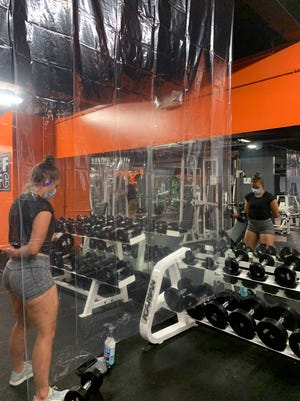 A member works out in her own area at Ciccone Family Fitness, in Clinton.