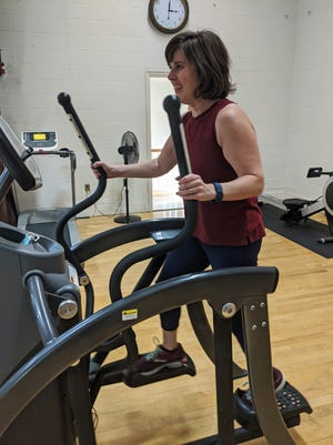 Lancaster resident Pam Weir uses the elliptical machine at Lancaster's Backstage Gym.