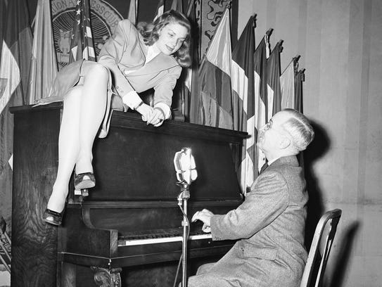 Vice President Harry Truman plays the piano as Lauren
