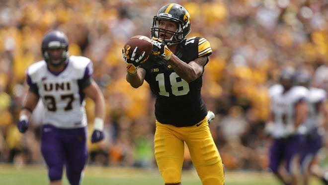 Iowa freshman receiver Derrick Willies reaches out for a pass completion against Northern Iowa on Saturday, Aug. 30, 2014, at Kinnick Stadium in Iowa City, Iowa.