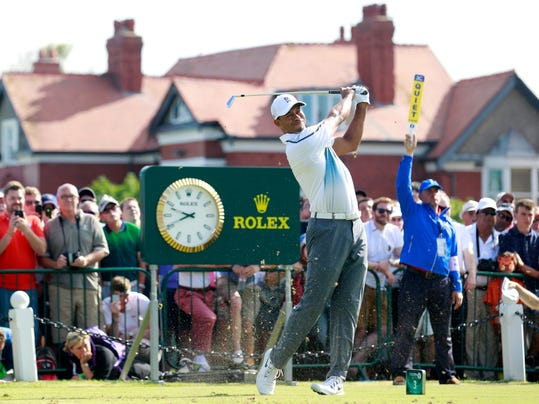 Tiger Woods of the US plays a shot off the 2nd tee during the first day of the British Open Golf championship at the Royal Liverpool golf club, Hoylake, England, Thursday July 17, 2014. (AP Photo/Peter Morrison)