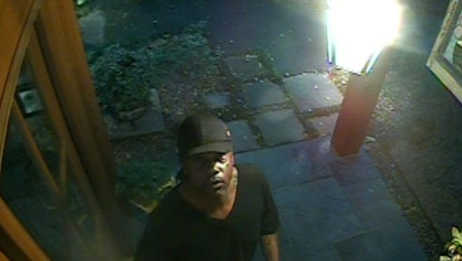 Surveillance video captured this image of one of two men suspected of breaking into a home on Brushwood Drive on Monday.