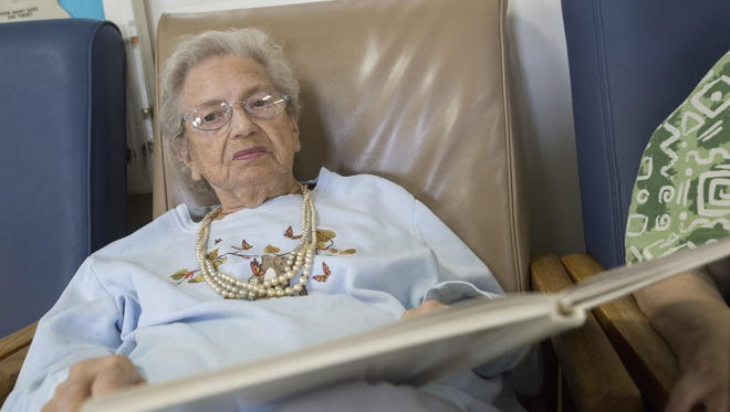 Violet Tisor pauses from singing hymns during activity time July 30 at the Davis Center, a nursing home near Bloomfield that specializes in handling elderly people with mental illness.