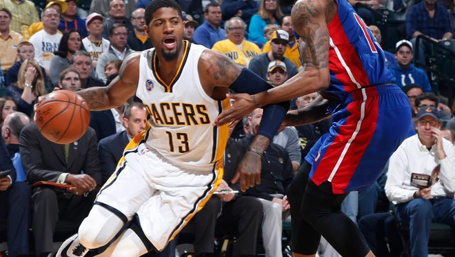 Pacers forward Paul George (13) is guarded by Pistons forward Marcus Morris (13) during the Pistons' 94-82 loss Saturday in Indianapolis.