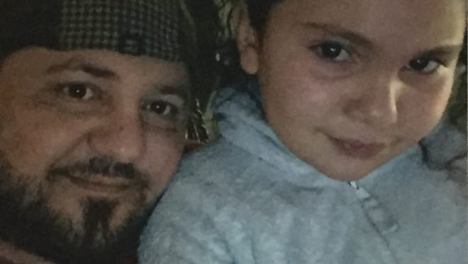 Family photo of Haydar Butris with one of his daughters. Butris was detained on June 11, 2017, by ICE immigration agents and could be deported to Iraq. He is Christian and would face persecution there, said family members.