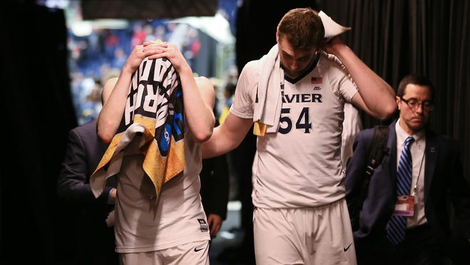 Xavier Musketeers guard J.P. Macura (55), left, and Xavier Musketeers forward Sean O'Mara (54) react to the 75-70 loss to the Florida State Seminoles during the second-round West Region NCAA Tournament game between the Xavier Musketeers and Florida State Seminoles, Sunday, March 18, 2018, at Bridgestone Arena in Nashville. Xavier lost 75-70.