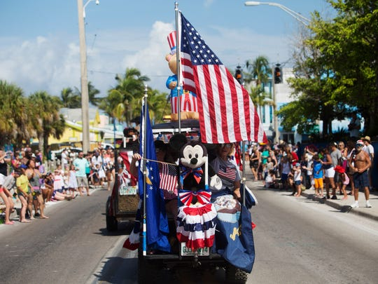 A patriotic golf cart adorned with Amercan flags and a Mickey Mouse participated in the Fourth of July Parade on Fort Myers Beach Monday.