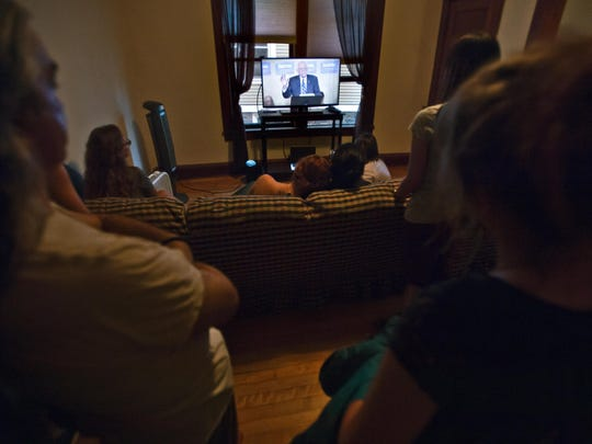 Supporters of Sen. Bernie Sanders watch his address via live stream Wednesday night at the apartment of Sarang Murthy on Isham Street in Burlington.
