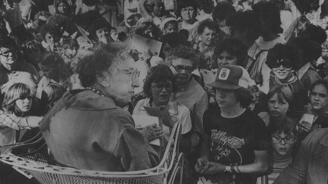 """Margaret Hamilton, who played the Wicked Witch of the West in the movie """"The Wizard of Oz,"""" signs autographs while appearing in 1979 in Topeka to take part in the Oz II festival on the grounds of the Kansas Statehouse."""