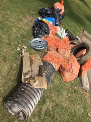 More than 200 pounds of trash was removed from a 2-mile stretch of the Clinton River at Yates Park in Rochester Hills on July 16.