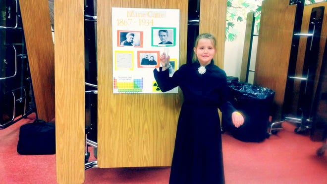 Casey Rogers as Marie Curie with her presentation on Friday at G.W. Stout Elementary.